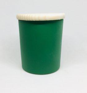 świeca w zielonej szklance